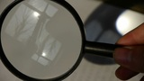 Focus Of Magnifying Glass,In Hand stock footage