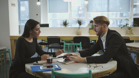 Business Partners At The Meeting. Lady Discusses Strategy With A Man stock footage