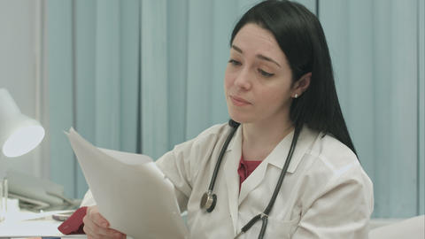 Doctor Analyzing Results An Electrocardiogram stock footage