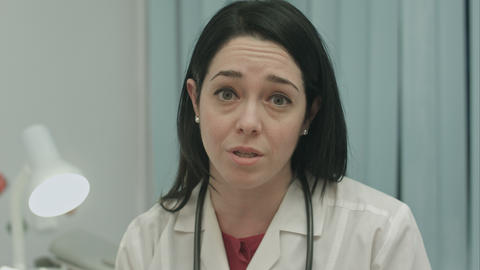 Serious Female Doctor Talking About A Illness And Result At Modern Hospital Indo stock footage