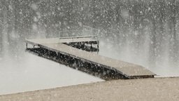 Thick Snowfall Over A Lake stock footage