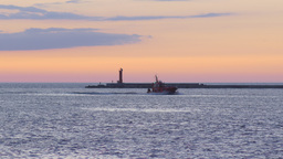 Pilot Ship Returning To Port During Vivid Summer Sunset stock footage