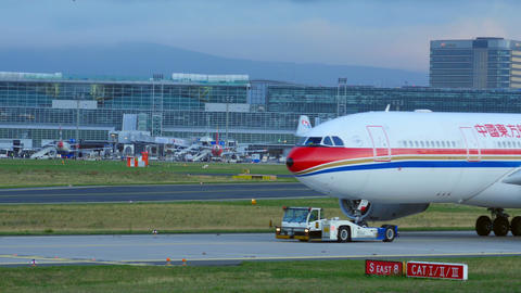 Towing China Eastern Airbus stock footage