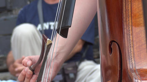 Detail Of A Man Playing The Cello In A Public Market 02a stock footage
