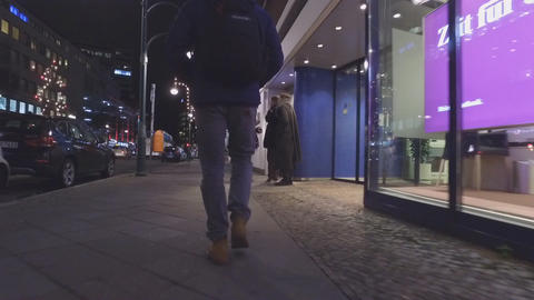 Tourist exploring city at night, in Berlin, Germany Footage