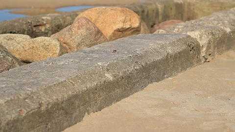 Sea Stones Concrete And Boat stock footage
