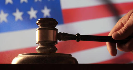 Judge calling order with hammer and gavel in american court with flag background Footage