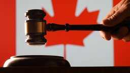 Judge calling order with hammer and gavel in canadian court with flag background Footage