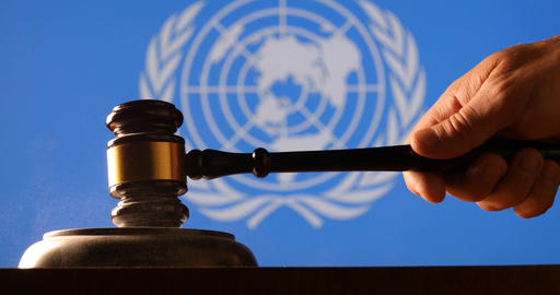 Judge calling order with hammer gavel in United Nations court flag background Footage