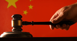 Judge calling order with hammer and gavel in china court with flag background Footage