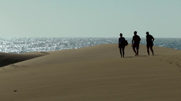 Spain The Canary Islands Gran Canary 004 Three Men On Dunes Of Maspalomas stock footage