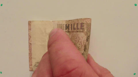 Paper Money 1000 Italian Lire On White Table Flipped A Hand Close Up stock footage