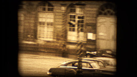 A TR2 Triumph Sports Car Pulls Away From The Camera stock footage