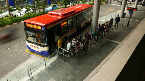 People Queue Walk Into Public Bus, Depart From Terminal Station, Time Lapse stock footage