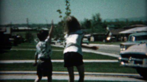 1961: New Family Car Pulls Into Driveway For Inspection By Excited Family stock footage