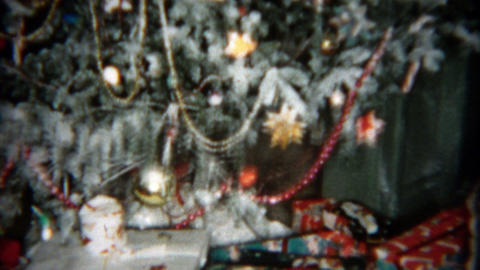 1955: Christmas Tree Tilt Up With Bountiful Gifts Ornaments And Glitter stock footage