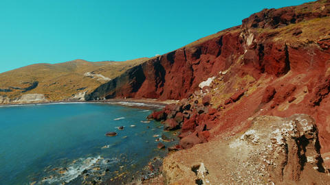Panning Shot of Red Volcanic Coast in the Mediterranean Footage