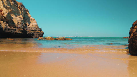 Low Angle Beach Shore Shot In The Algarve, Portugal stock footage