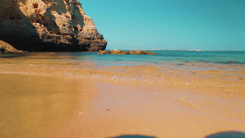 Slider Low Angle Beach Shore Shot In The Algarve, Portugal stock footage