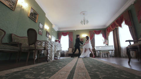 Bride and groom dancing in the beautiful interior Footage