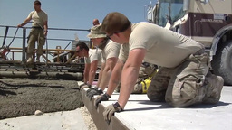 Pouring Concrete To Repair Runway stock footage