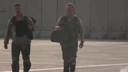 Pilots walk towards their airplane the A-10 Thunderbolt II fighter jet Footage