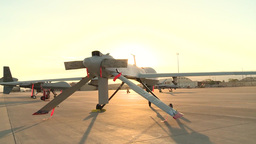 MQ-1's And MQ-9's UAv Drones Sitting On The Flight Line Of Holloman AFB stock footage