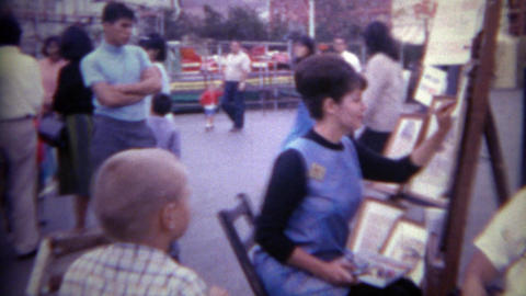 1965: Man gets caricature drawing done by carnival circus lady amauter artist. S Footage