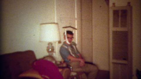 1965: Injured Man Embarrassingly Uses Door Hanging Neck Brace To Heal Self. SAN  stock footage