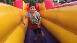 Child exercise on inflatable bouncy castle Footage