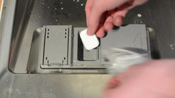 Insert Detergent Tablet To The Dishwasher (opening For Tablet) stock footage