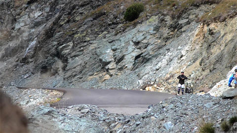 Cyclist On A Road That Climbs The Ramp, Take A Break And Rest On The Roadside Wh stock footage