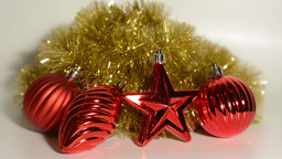 Christmas Decoration - Red Ornaments With Gold Chain - White Background stock footage
