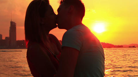 Young Couple At Beach Talk And Kiss At Sunset stock footage