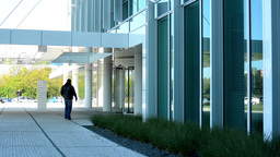 modern building and people entering into the building Footage