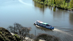 boats on the river Vltava with the bank of the river Footage