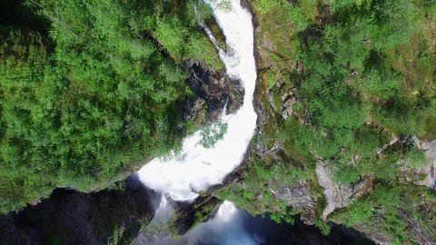 Flying above Voringfossen waterfall in Norway, popular tourist attraction Footage