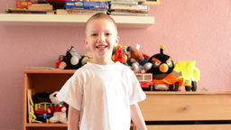 Child(small Boy) Plays In The Room - Child Jumps And Smiles stock footage