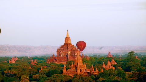Hot air balloons flying over ancient Buddhist Temples at Bagan. Myanmar Footage