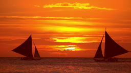 Tropical Sunset. Sail Boats Silhouettes On Ocean Horizon. Boracay, Philippines stock footage