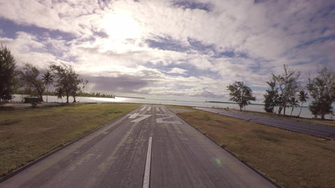 Takeoff Towards Coconut Island And Solar Panels Along The Runway - Tetiaroa, Tah stock footage
