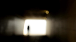 Light At End Of Tunnel - Man Walks - Blurred Shot stock footage