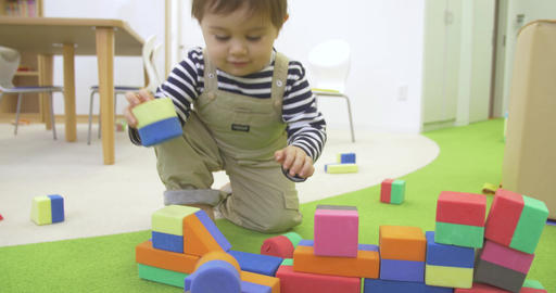 Toddler Smiles And Plays With Blocks stock footage