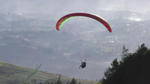 Rainbow Colored Paraglide Flying At Low Altitude stock footage