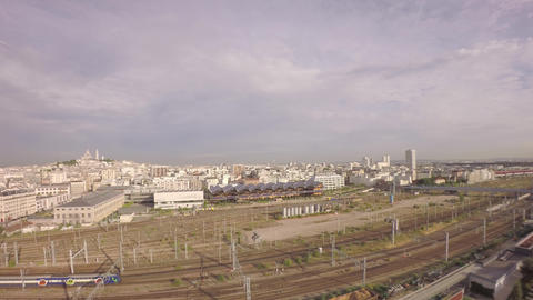 Aerial View Of TGV High Speed Train Passing At Gare Du Nord And Tilt Up Of City  stock footage