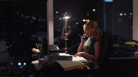 4 Businesswoman Working Late At Night Answering Phone Call stock footage