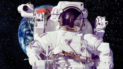 Astronaut On A Spacewalk With The Planet Earth In Background stock footage