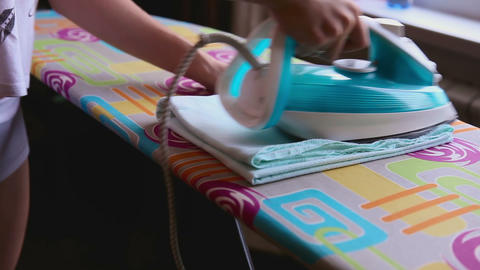 Ironing of baby diaper Footage