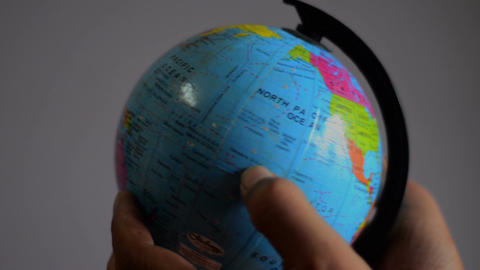 Close Shot Of Globe Studying stock footage