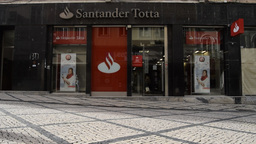 People Walk Past The Coimbra Branch Of Santander Totta Bank In Portugal stock footage